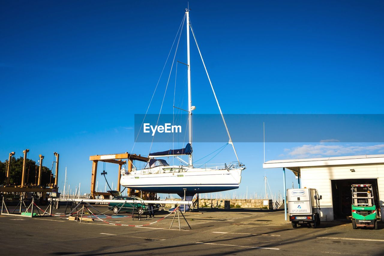 transportation, mode of transport, nautical vessel, day, blue, outdoors, sky, stationary, no people, clear sky, moored, mast, nature