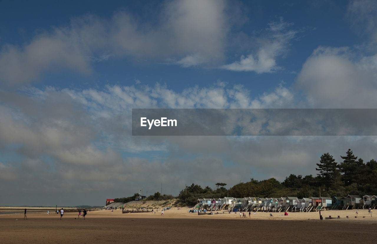cloud - sky, sky, land, beach, sand, nature, scenics - nature, group of people, day, real people, beauty in nature, tree, water, tranquil scene, outdoors, men, large group of people, landscape, sea, incidental people