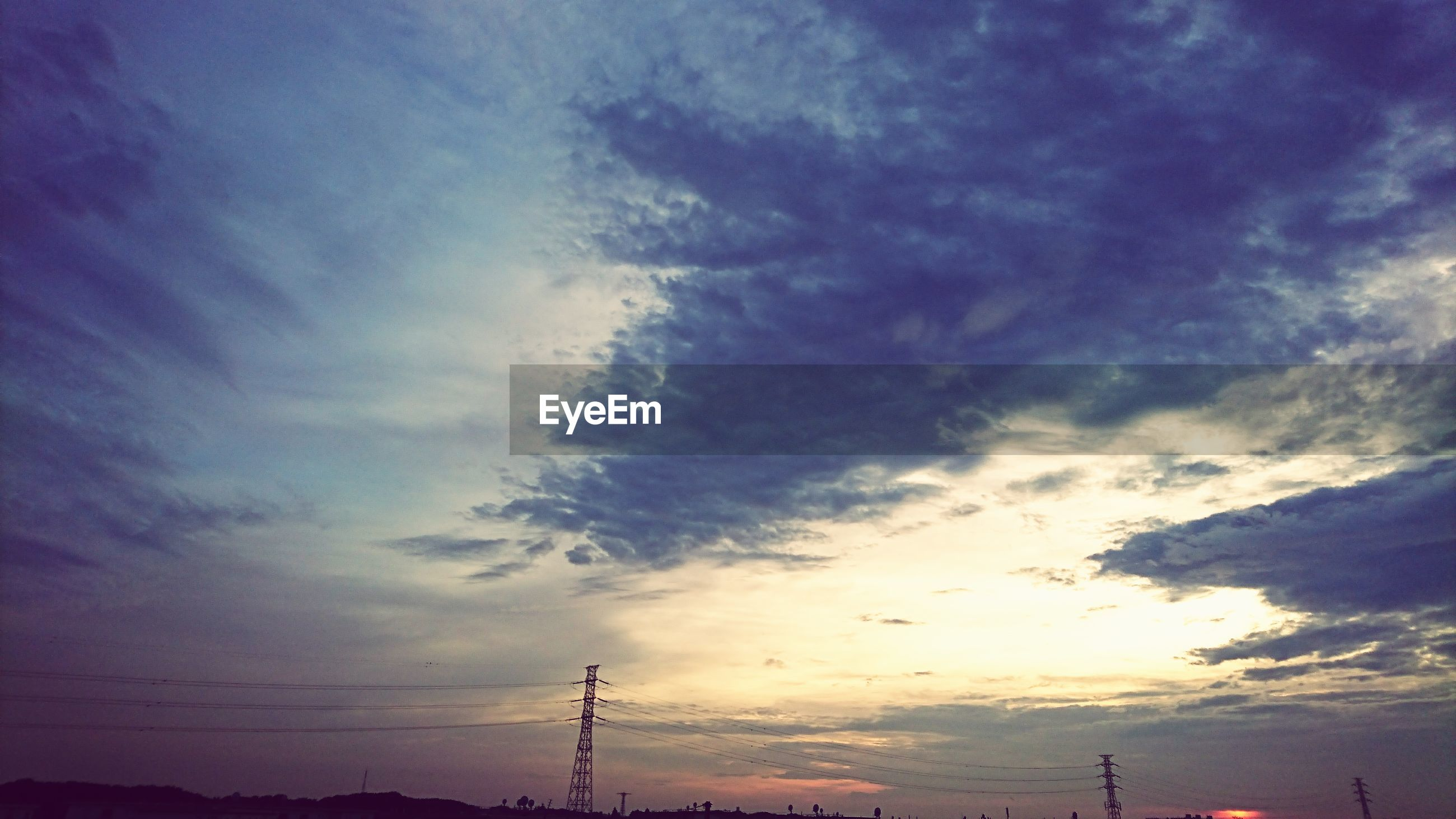 cloud - sky, sky, silhouette, sunset, nature, low angle view, no people, beauty in nature, connection, scenics, tranquility, outdoors, electricity pylon, technology, day