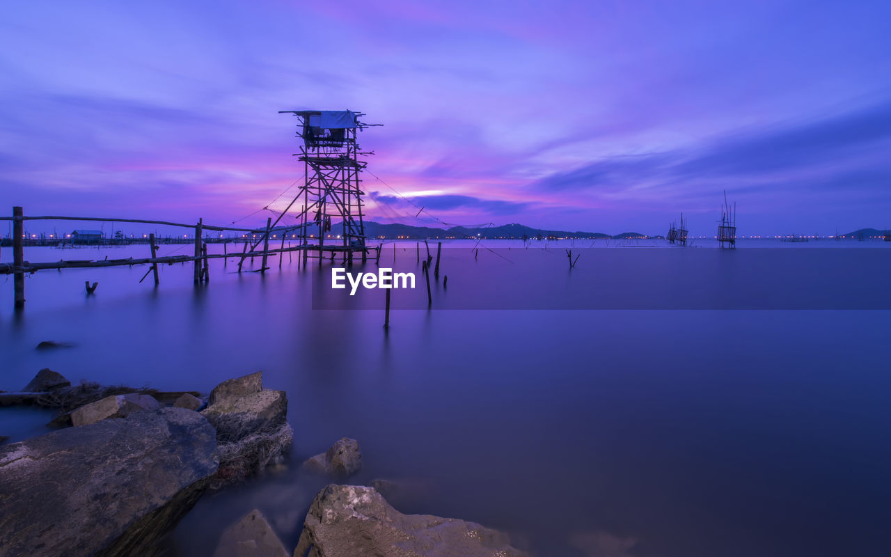 Lookout Tower On Seascape Against Sky During Sunset