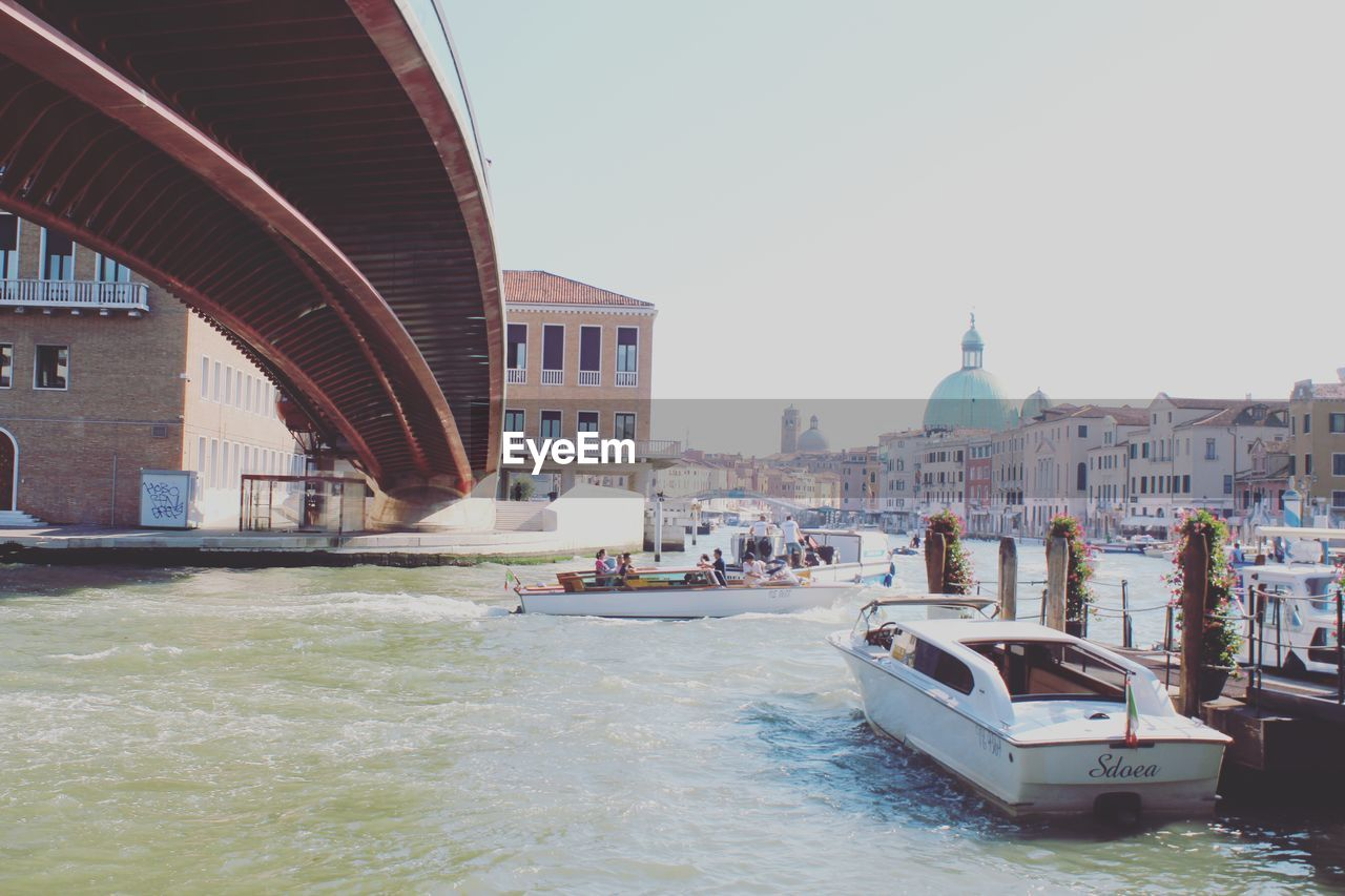 built structure, architecture, building exterior, water, transportation, nautical vessel, sky, mode of transportation, waterfront, clear sky, nature, city, canal, building, day, bridge, no people, sea, bridge - man made structure, outdoors, passenger craft, wooden post