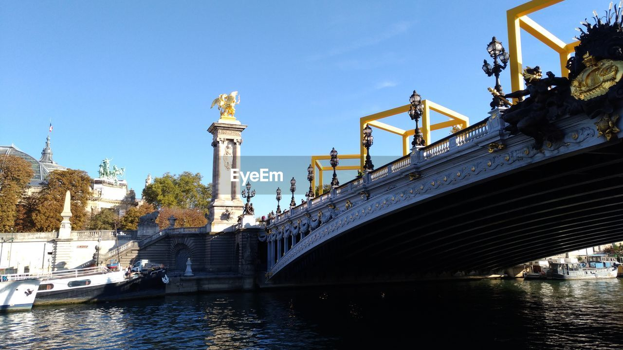 transportation, built structure, architecture, water, sky, bridge - man made structure, bridge, connection, nature, mode of transportation, nautical vessel, day, travel, building exterior, river, travel destinations, no people, clear sky, waterfront, outdoors