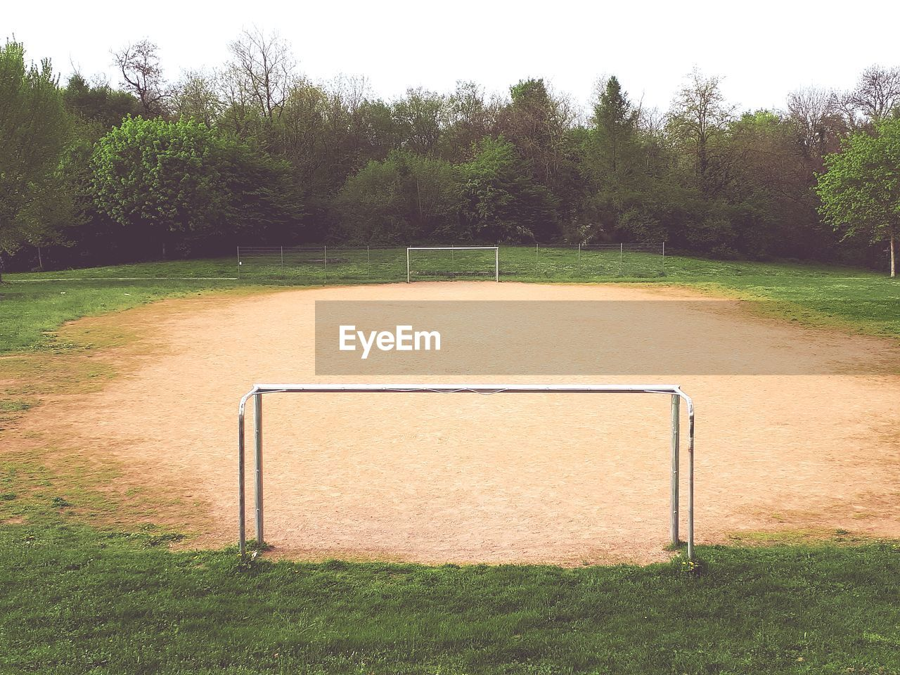 plant, grass, tree, sport, team sport, playing field, nature, soccer, land, day, field, soccer field, tranquility, soccer goal, growth, goal post, no people, football, absence, empty, outdoors