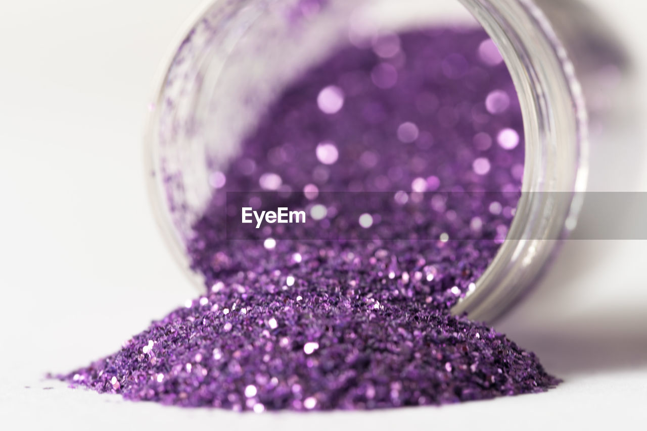 Close-up of glitter against white background