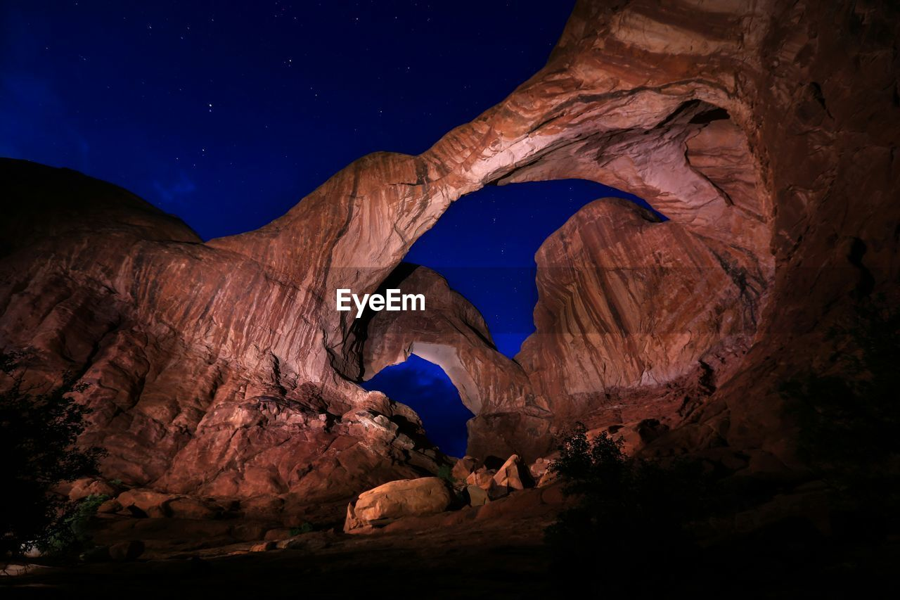 Low angle view of double arch at arches national park