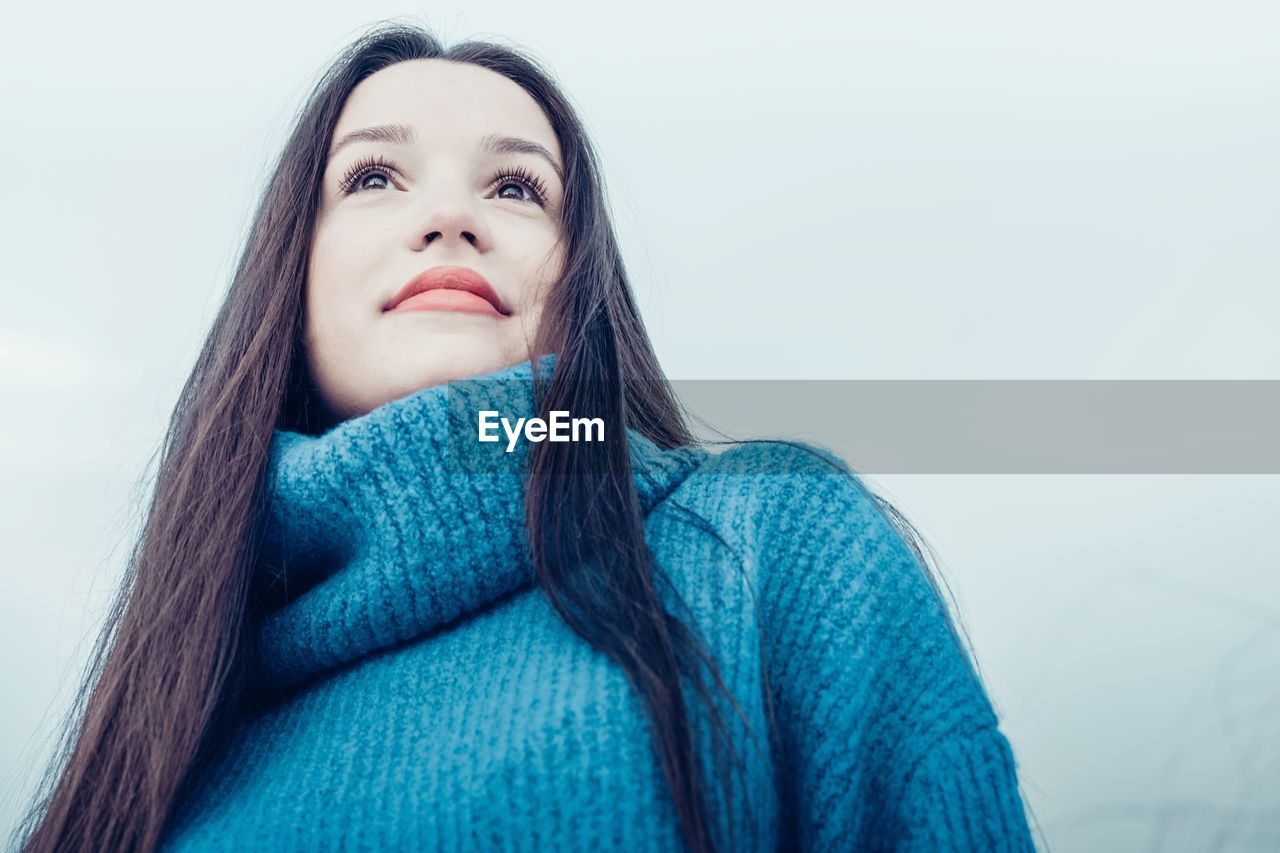 Low Angle View Of Young Woman