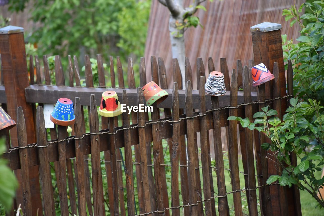 CLOTHES HANGING ON WOODEN FENCE