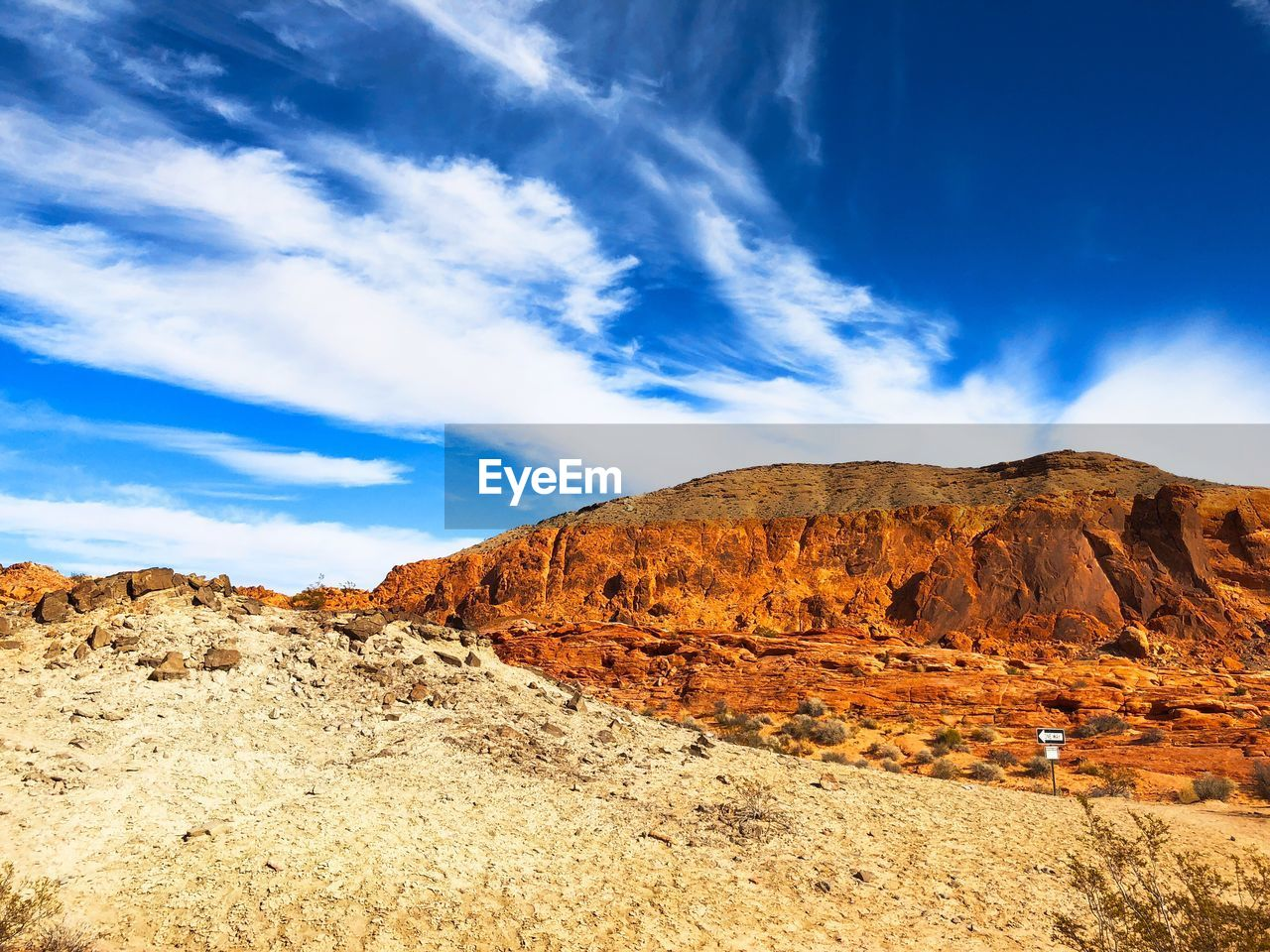 sky, scenics - nature, tranquil scene, cloud - sky, beauty in nature, tranquility, mountain, non-urban scene, environment, rock, landscape, nature, blue, desert, rock formation, remote, rock - object, mountain range, no people, idyllic, climate, arid climate, formation, outdoors, eroded