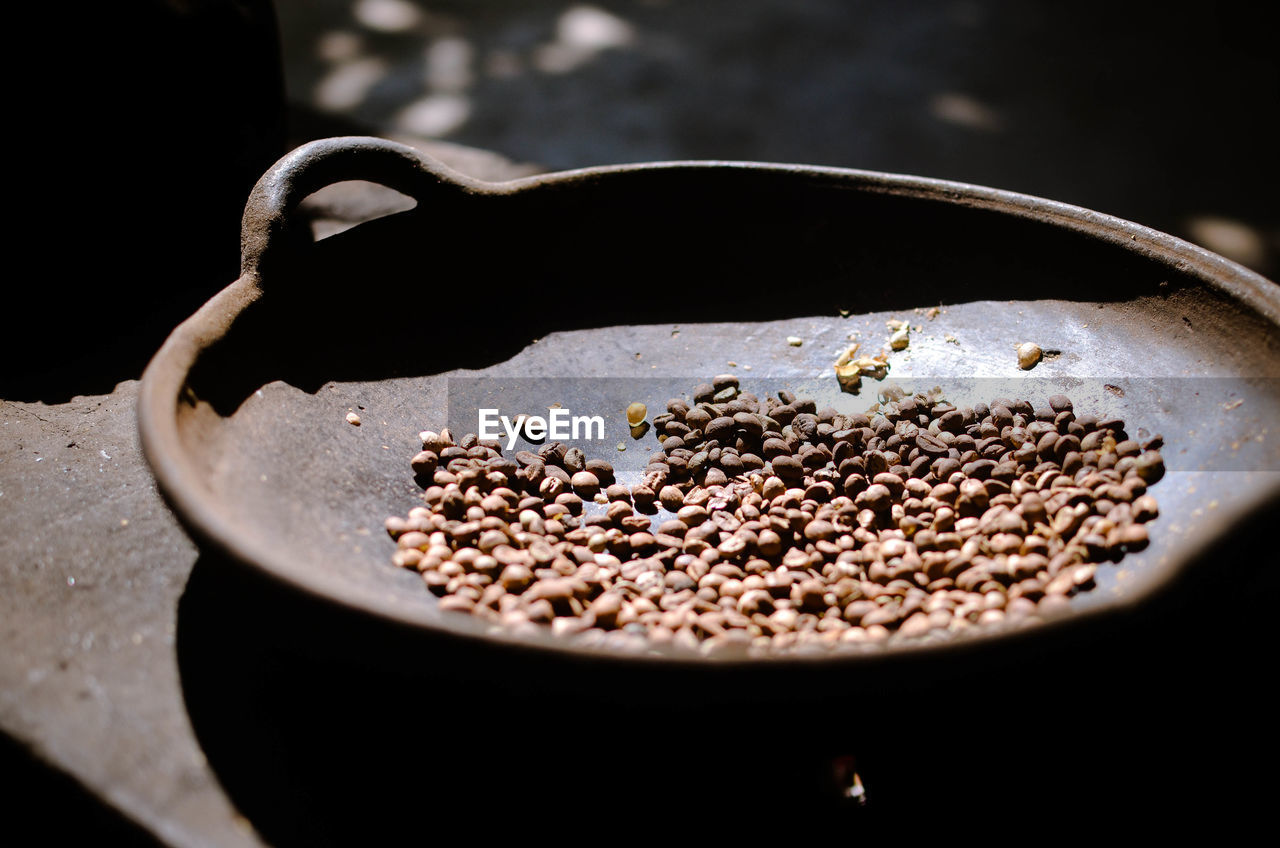 Sunlight falling on coffee beans in container