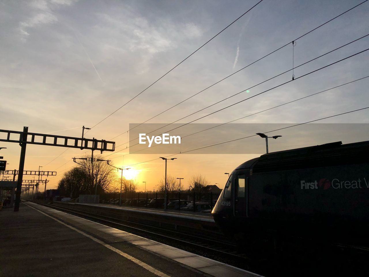 sunset, transportation, sky, rail transportation, railroad track, cable, silhouette, railway, travel, public transportation, no people, train - vehicle, outdoors, architecture, day