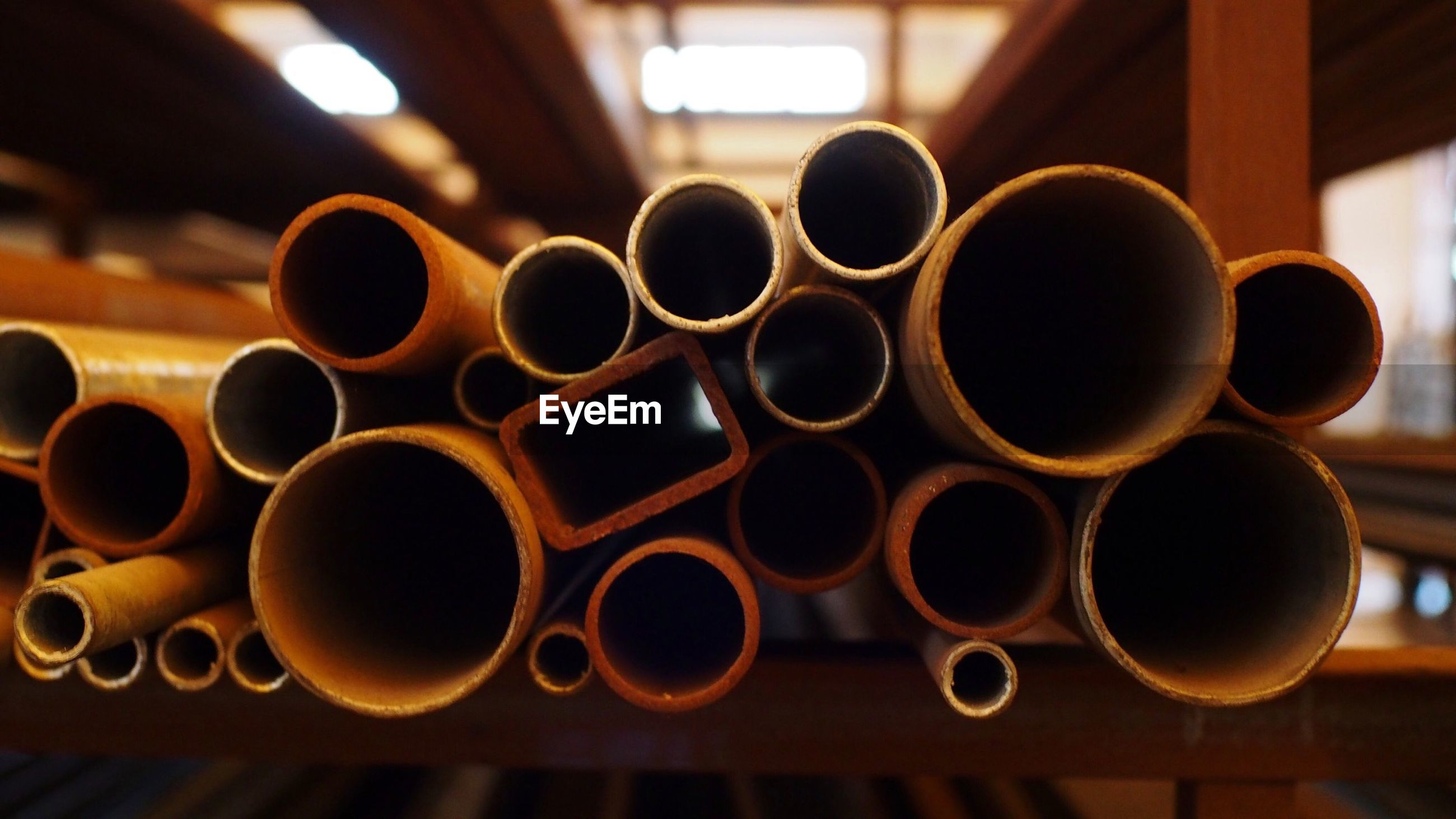 Close-up of metallic pipes at factory
