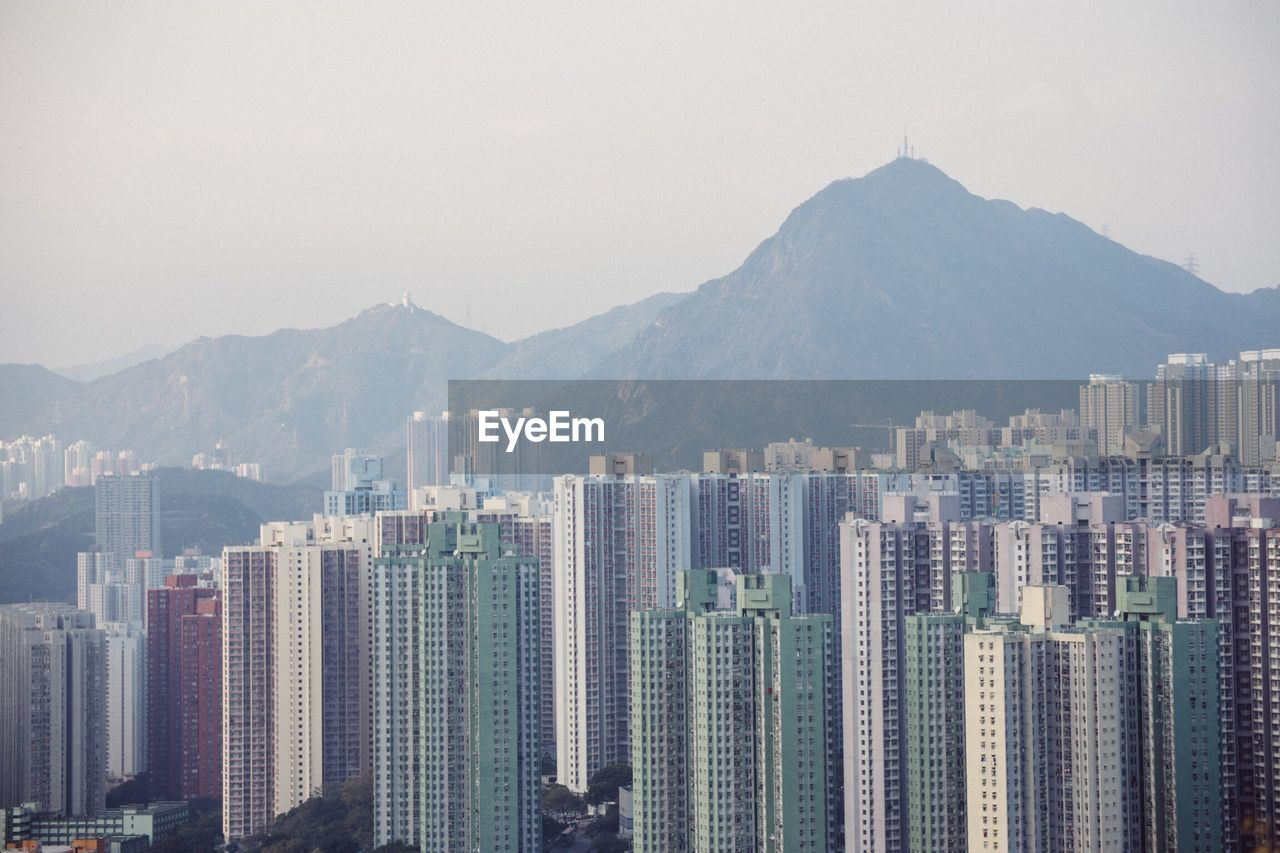 View Of Cityscape With Mountain Range In Background