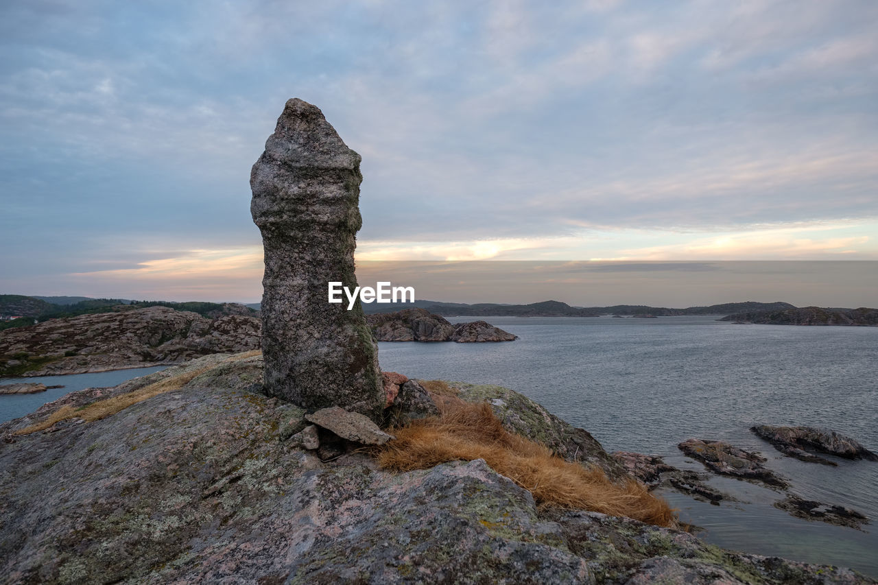 sky, rock, rock - object, solid, beauty in nature, scenics - nature, cloud - sky, water, tranquility, sea, sunset, tranquil scene, nature, rock formation, non-urban scene, no people, beach, land, idyllic, outdoors, eroded, rocky coastline