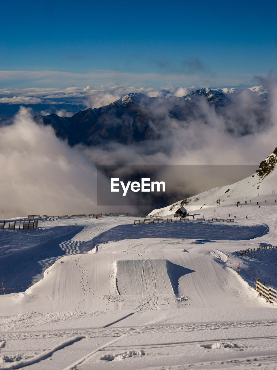 People Skiing At Treble Cone Against Sky
