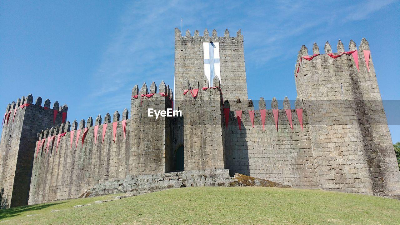 Low angle view of guimaraes castle against sky