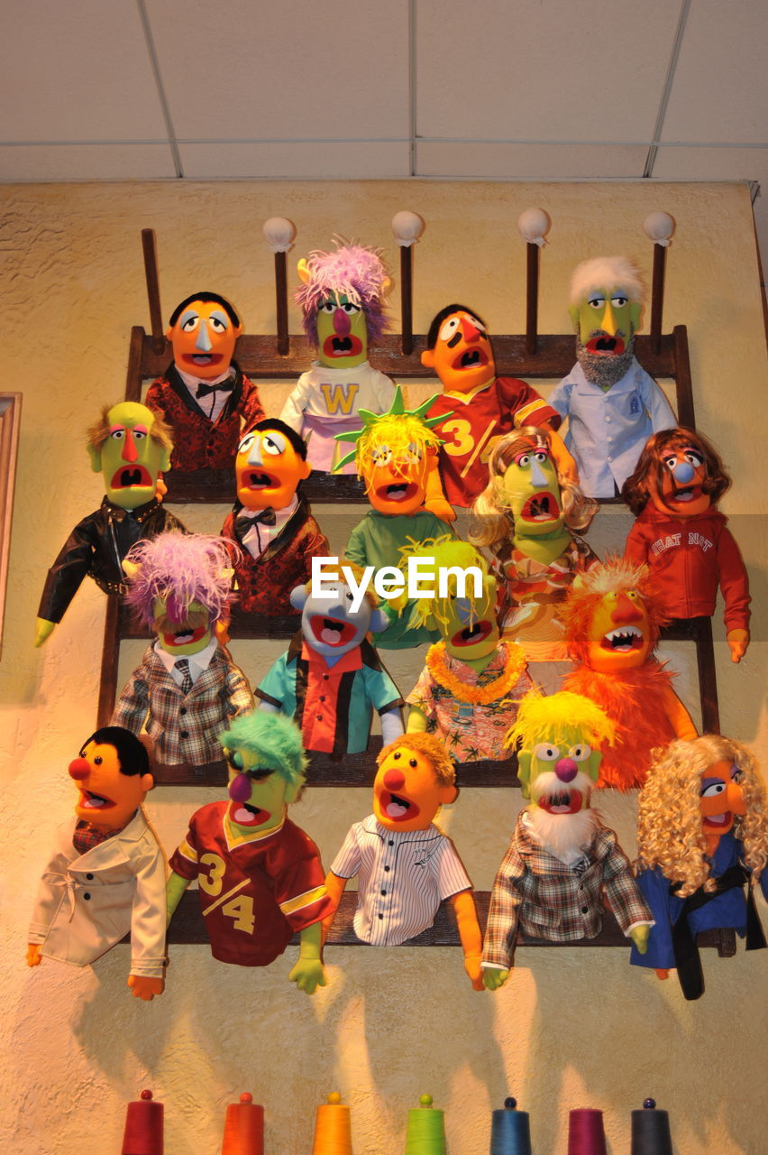 human representation, art and craft, childhood, multi colored, medium group of people, day, boys, indoors, clown, people
