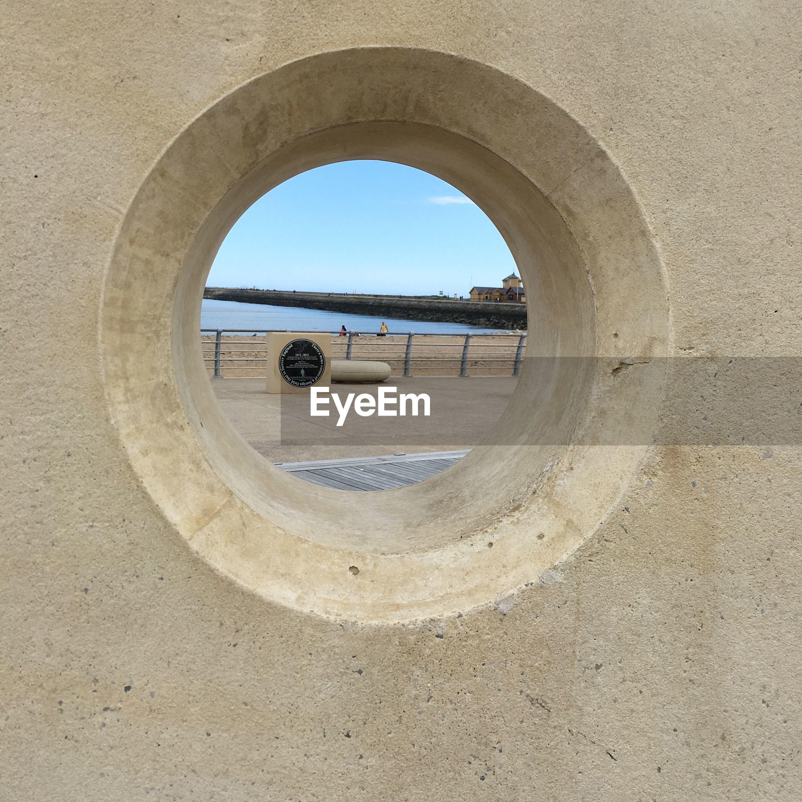 River seen through hole against sky