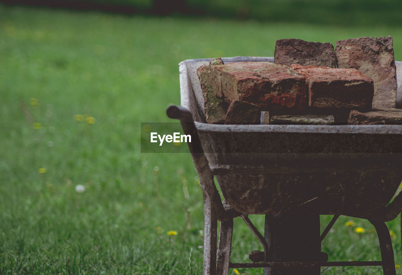 Bricks In Wheelbarrow On Grass