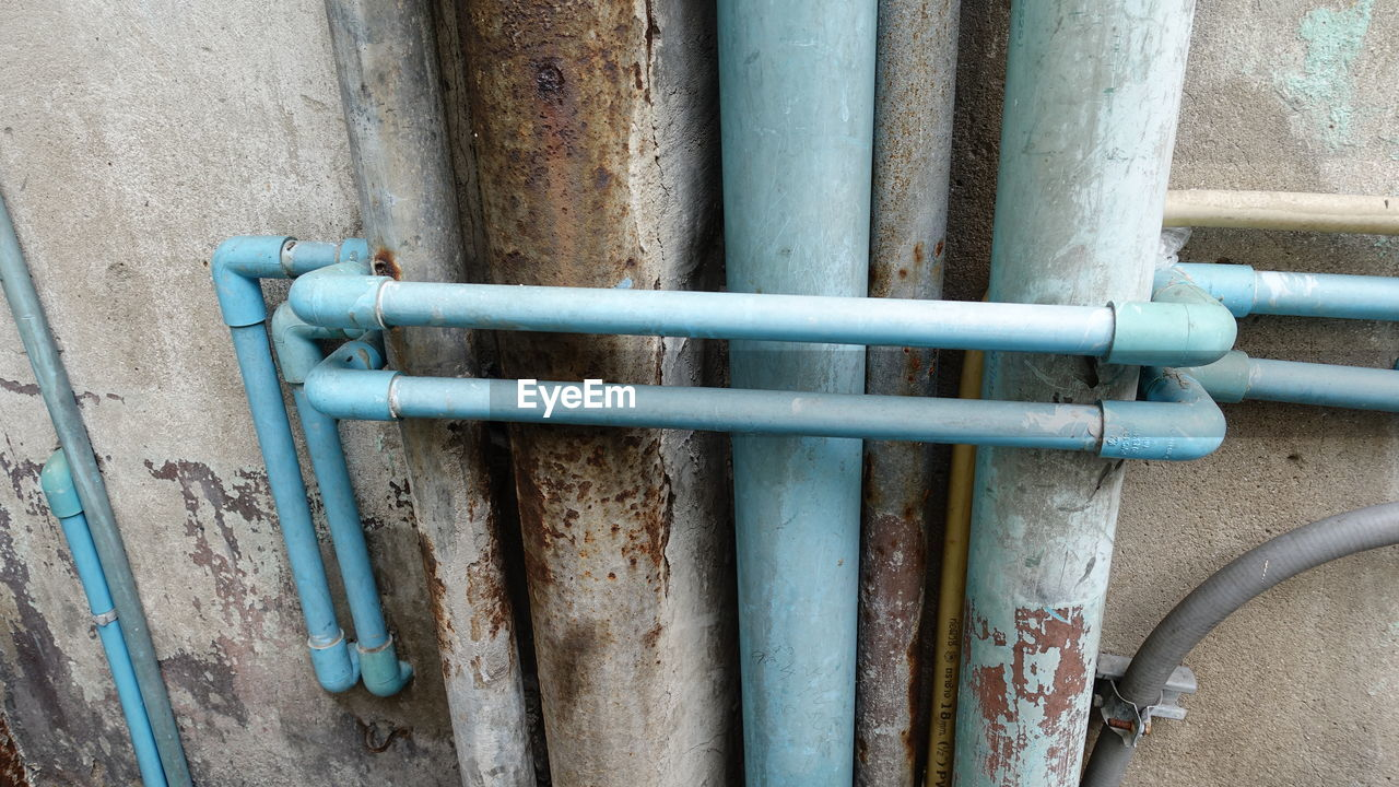 pipe - tube, pipeline, no people, metal, water pipe, pipe, day, outdoors, architecture, built structure, close-up, building exterior