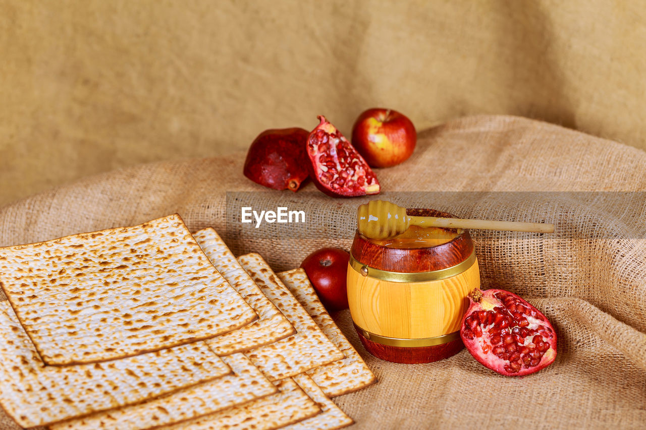 food and drink, food, fruit, healthy eating, wellbeing, freshness, indoors, still life, container, table, no people, berry fruit, wood - material, bottle, red, close-up, bread, jute, honey, breakfast