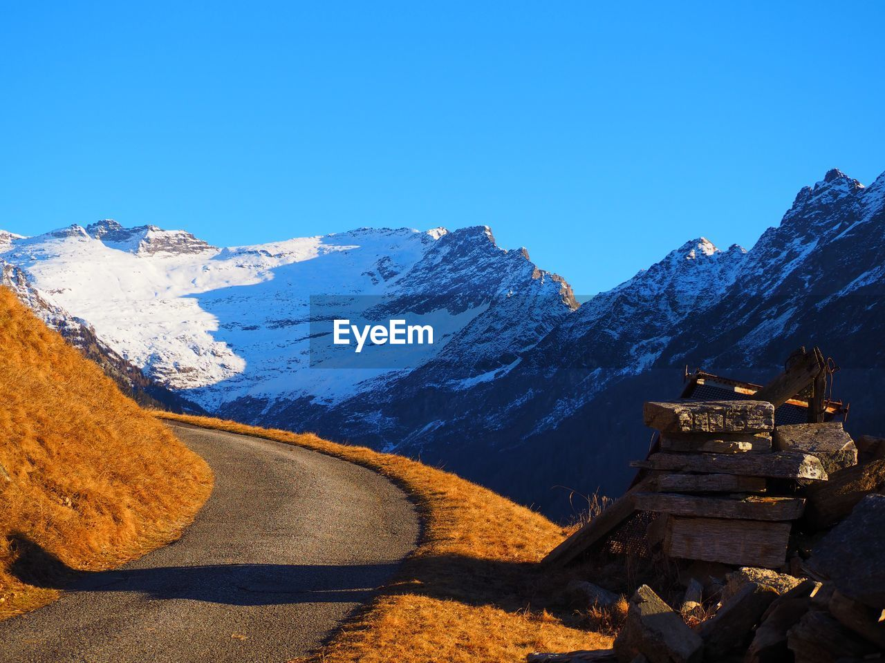 VIEW OF MOUNTAIN RANGE AGAINST CLEAR BLUE SKY