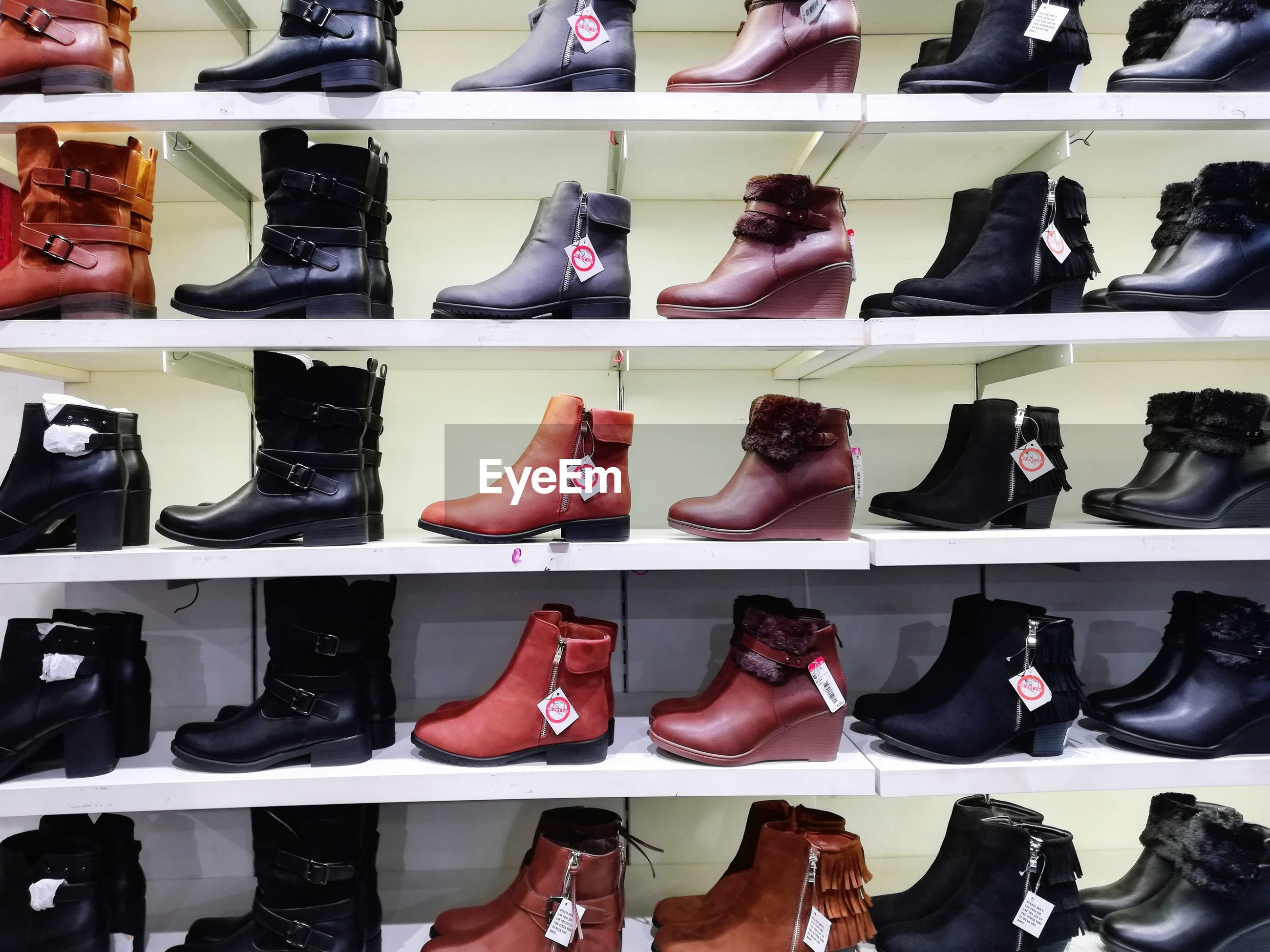 High angle view of shoes for sale at store