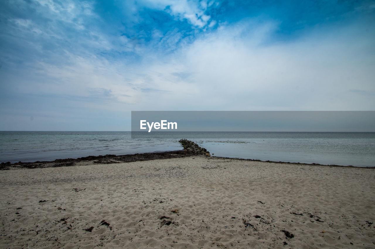 sea, water, land, sky, beach, horizon, sand, beauty in nature, tranquility, scenics - nature, horizon over water, tranquil scene, nature, cloud - sky, no people, remote, outdoors, idyllic, non-urban scene