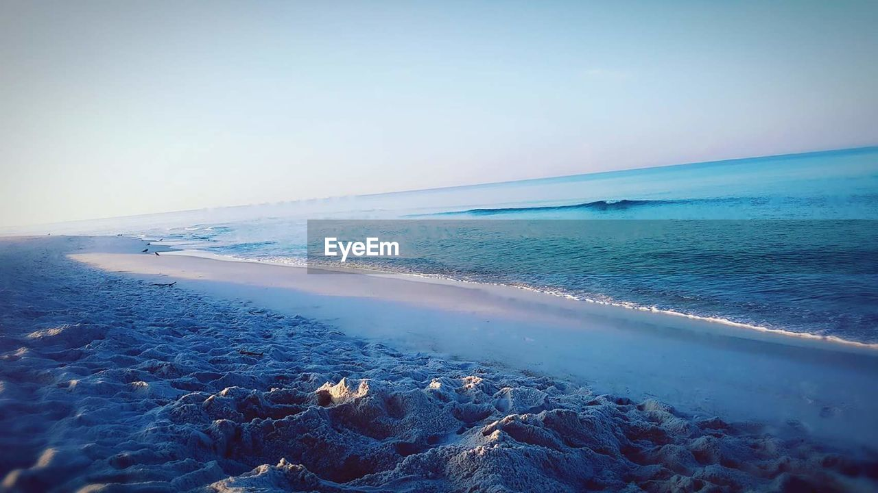 sea, horizon over water, water, scenics, nature, beauty in nature, sky, clear sky, tranquil scene, tranquility, outdoors, no people, day, beach, blue