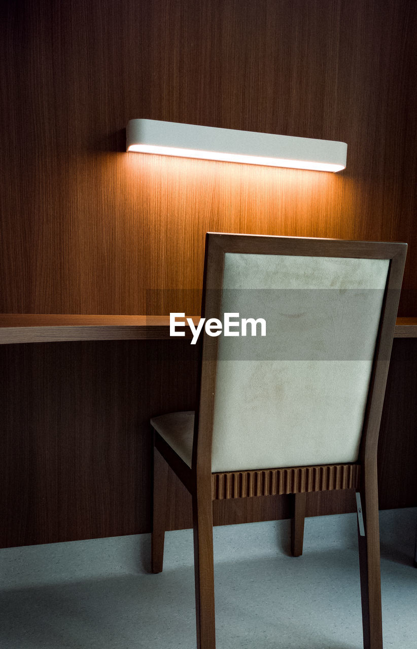 Close-up of empty chair on table at home