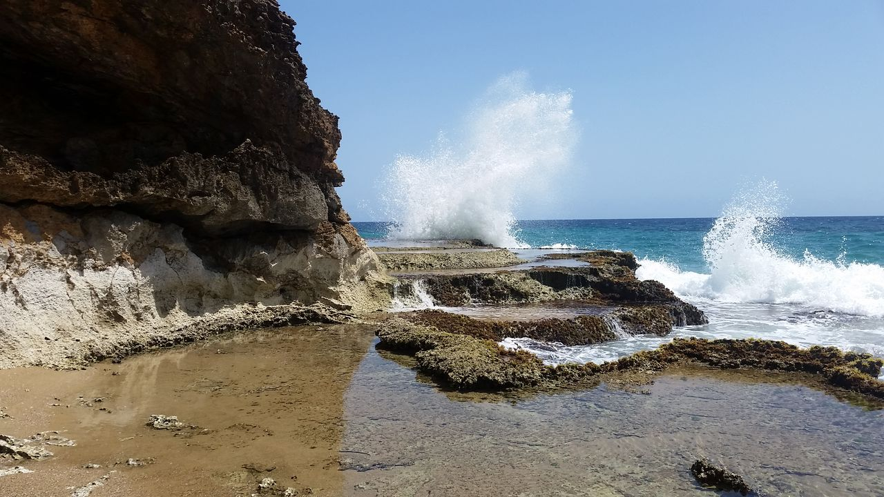 water, sea, motion, rock, solid, wave, power in nature, land, rock - object, beach, power, beauty in nature, sky, splashing, scenics - nature, rock formation, nature, day, aquatic sport, no people, horizon over water, hitting, breaking, outdoors, flowing