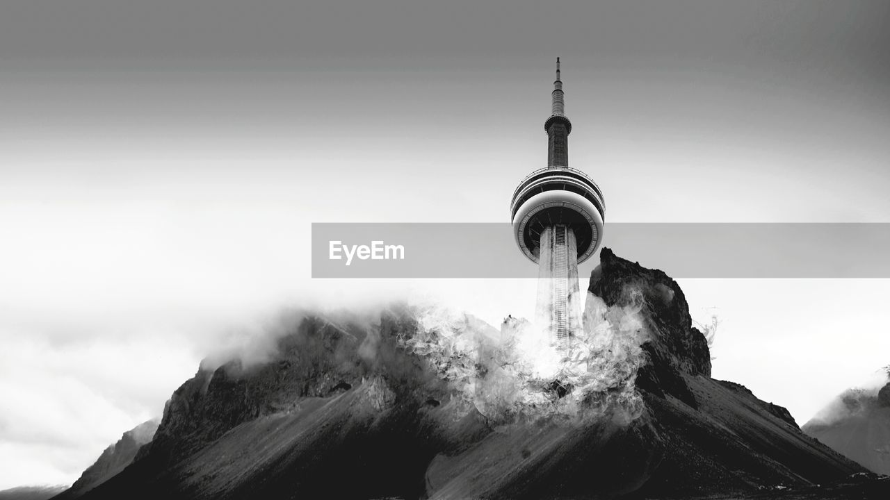 Digital Composite Image Of Cn Tower Amidst Mountain Against Sky