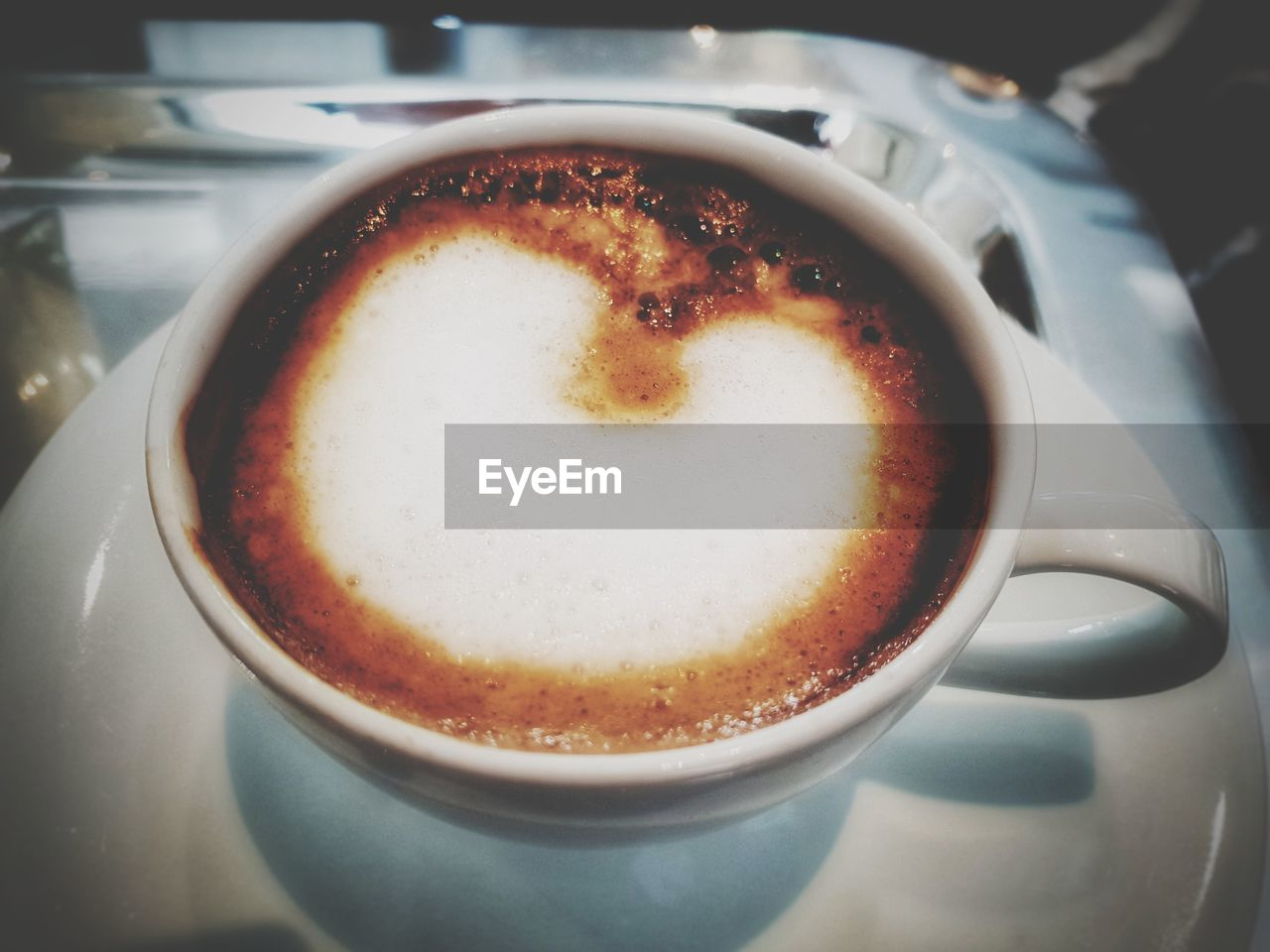 food and drink, drink, coffee, cup, mug, refreshment, coffee - drink, coffee cup, still life, close-up, table, frothy drink, crockery, indoors, saucer, freshness, no people, hot drink, cappuccino, food, latte, froth, non-alcoholic beverage
