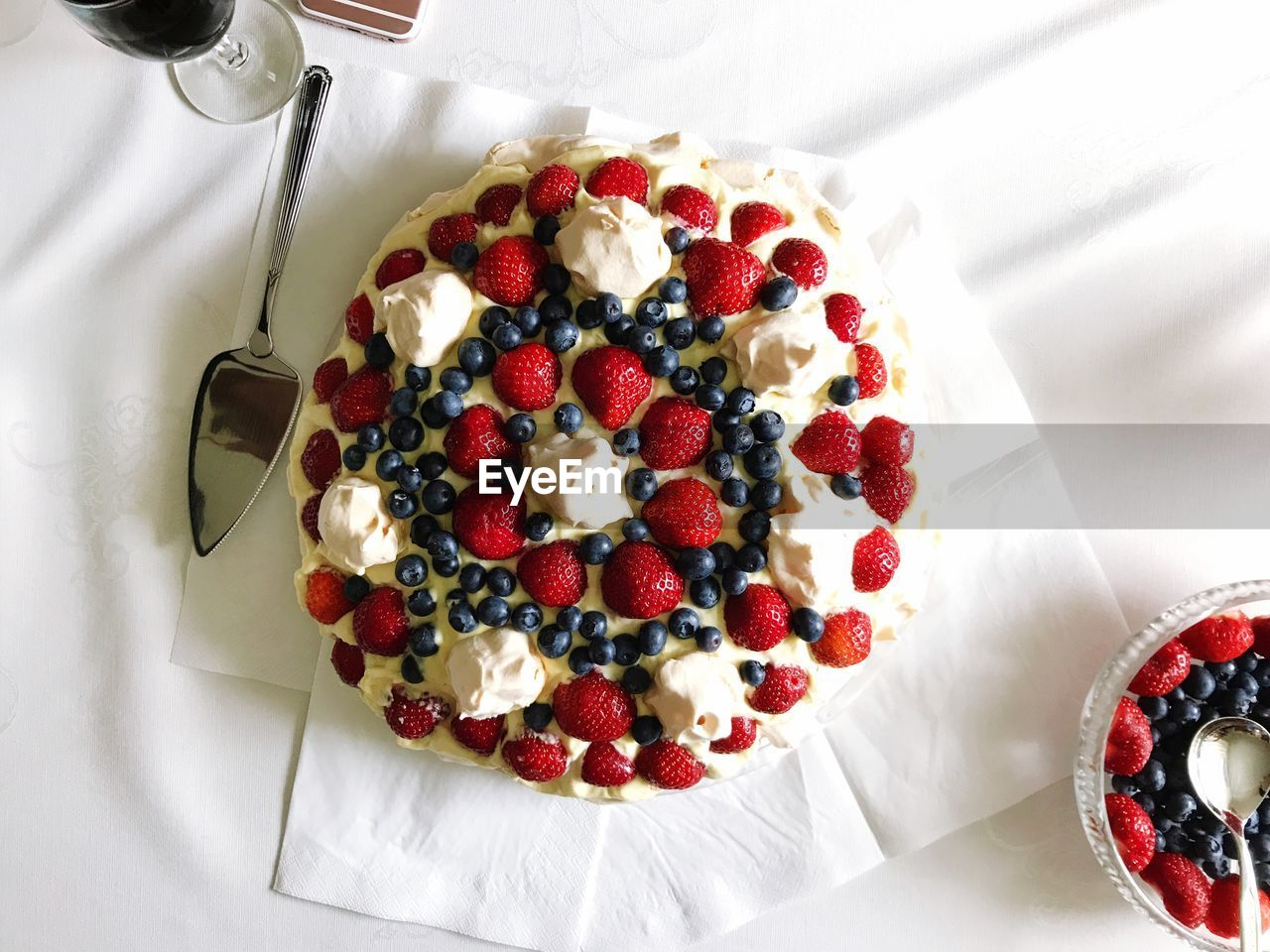 High angle view of cake on tablecloth