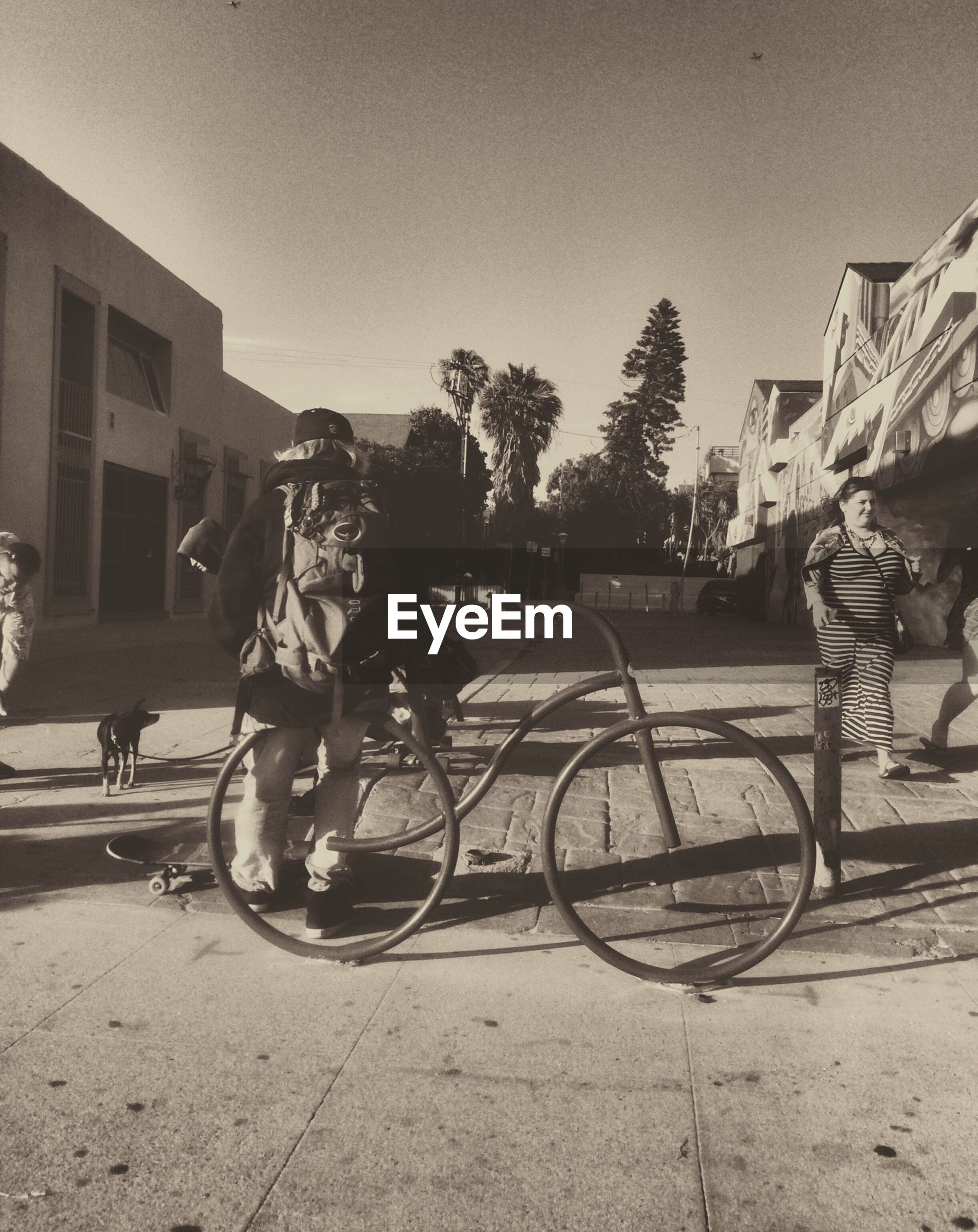 bicycle, transportation, land vehicle, mode of transport, lifestyles, men, building exterior, leisure activity, street, riding, built structure, architecture, full length, person, city, walking, stationary, tree