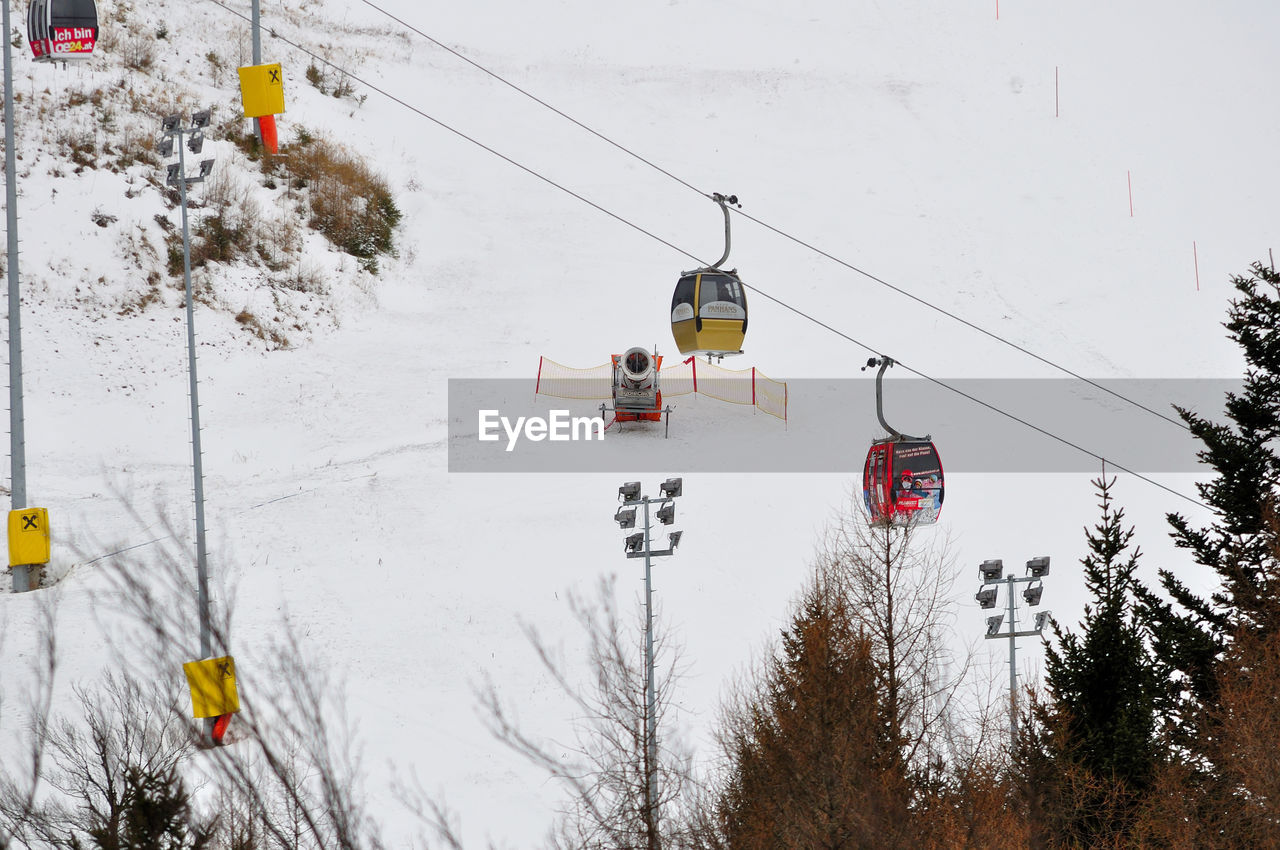 winter, cold temperature, snow, weather, nature, transportation, overhead cable car, tree, ski lift, day, outdoors, hanging, scenics, beauty in nature, sky, no people