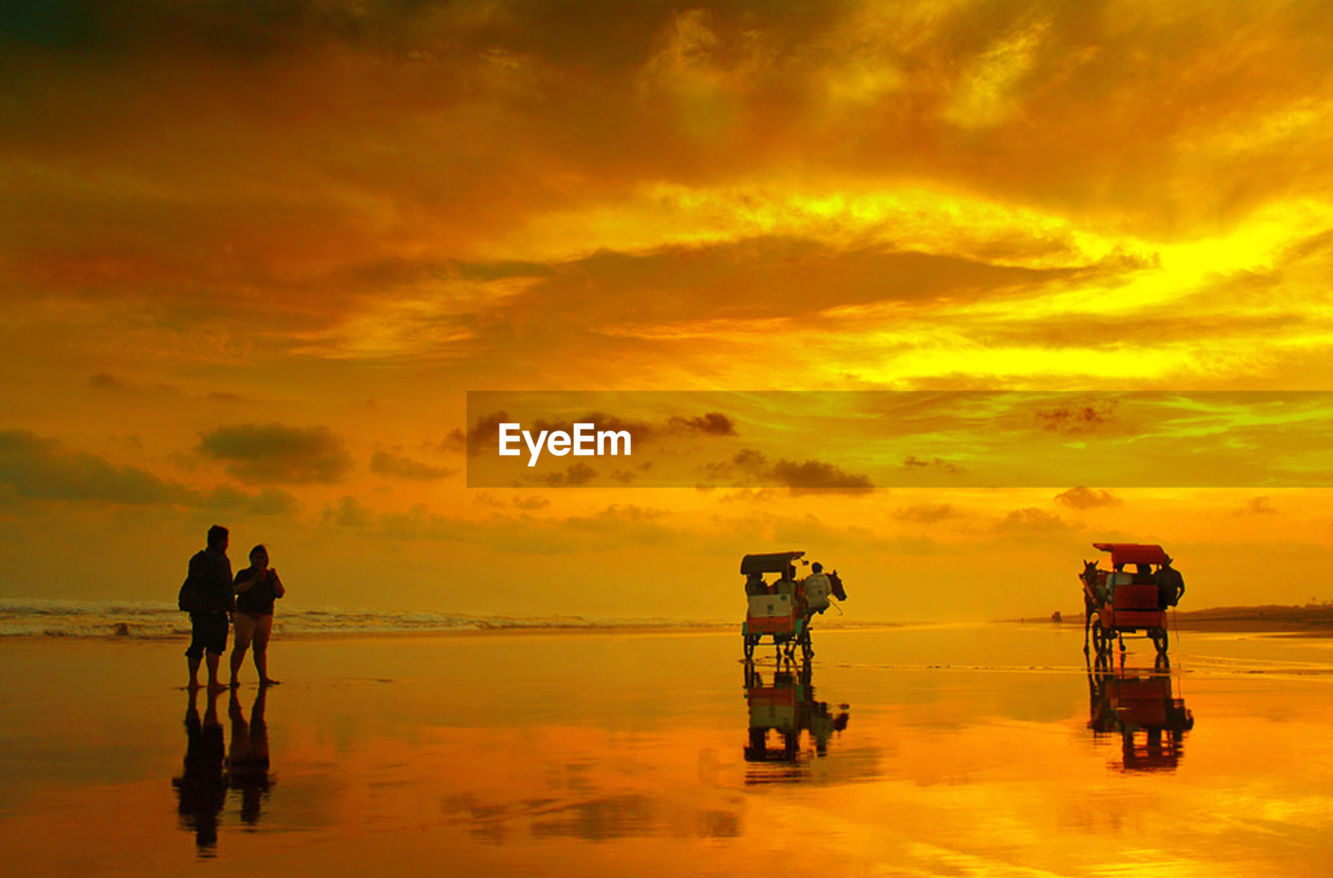sunset, sky, orange color, water, sea, men, horizon over water, transportation, lifestyles, silhouette, cloud - sky, mode of transport, beauty in nature, scenics, leisure activity, tranquility, beach, nature, cloud