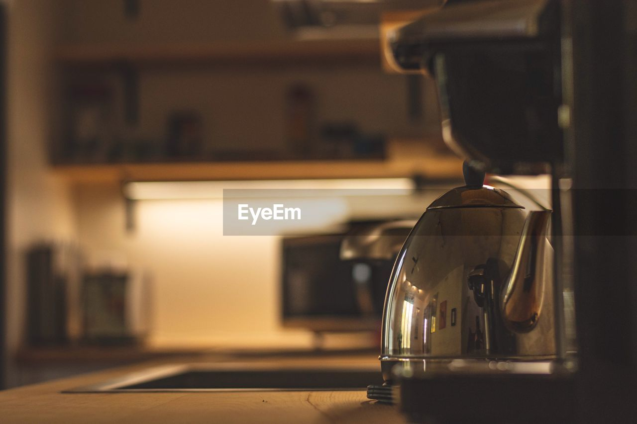 indoors, focus on foreground, home, appliance, domestic room, kitchen, no people, close-up, metal, domestic kitchen, household equipment, coffee maker, food and drink, still life, kitchen utensil, retro styled, home interior, selective focus, table, coffee pot