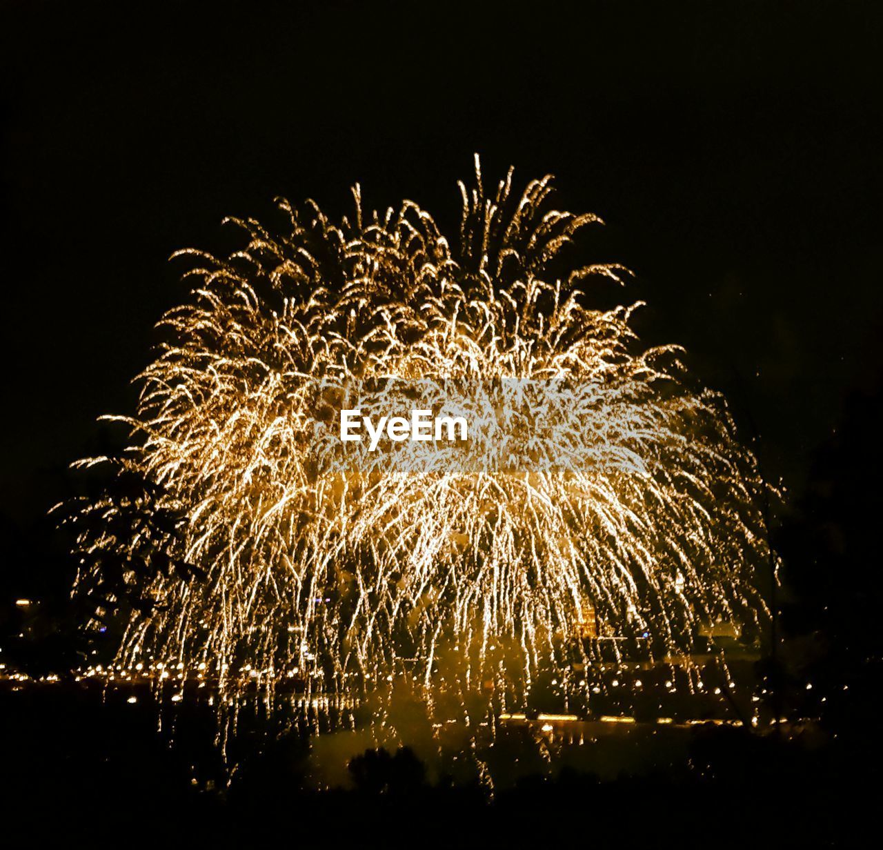 night, firework display, firework - man made object, long exposure, exploding, celebration, low angle view, arts culture and entertainment, illuminated, sparks, glowing, motion, event, blurred motion, no people, sky, outdoors, firework, multi colored, clear sky