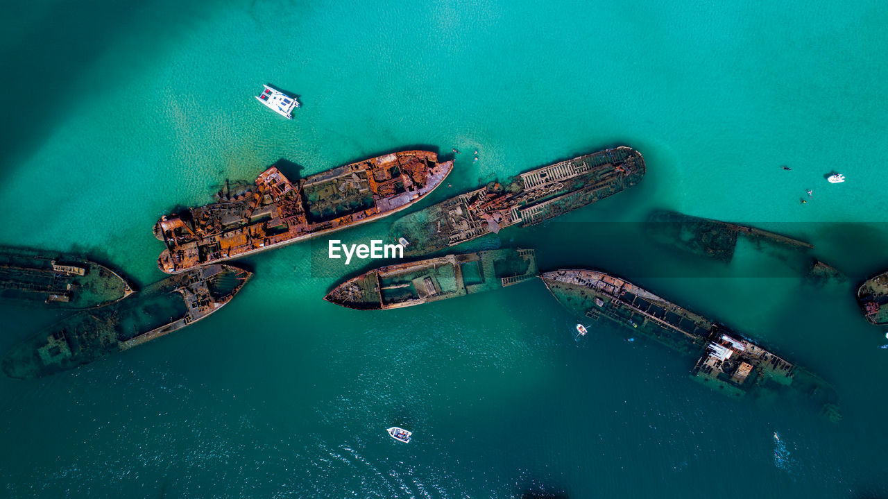 Aerial view of abandoned ships in sea