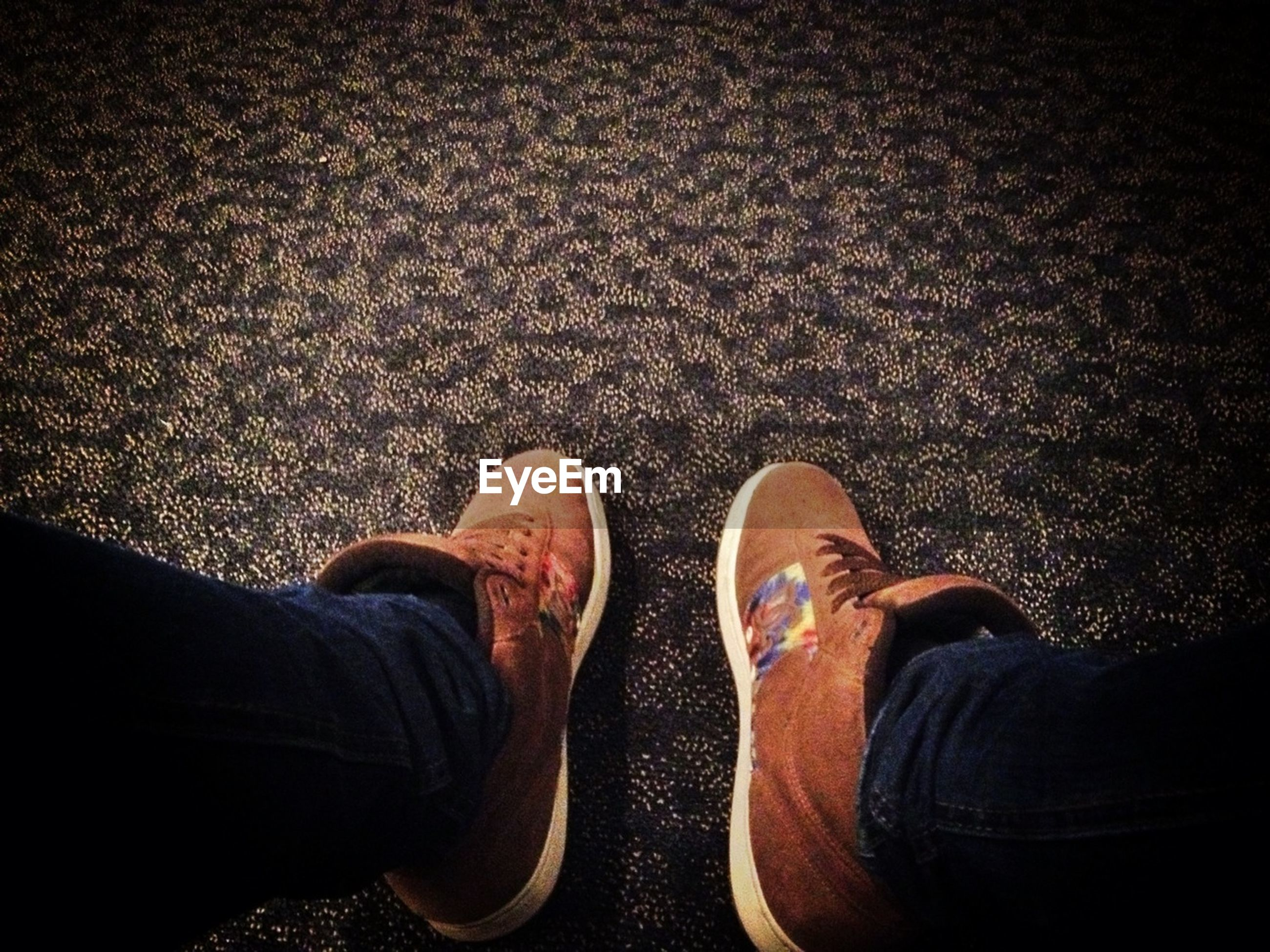 low section, person, shoe, personal perspective, footwear, human foot, lifestyles, standing, men, jeans, leisure activity, high angle view, street, canvas shoe, road, directly above