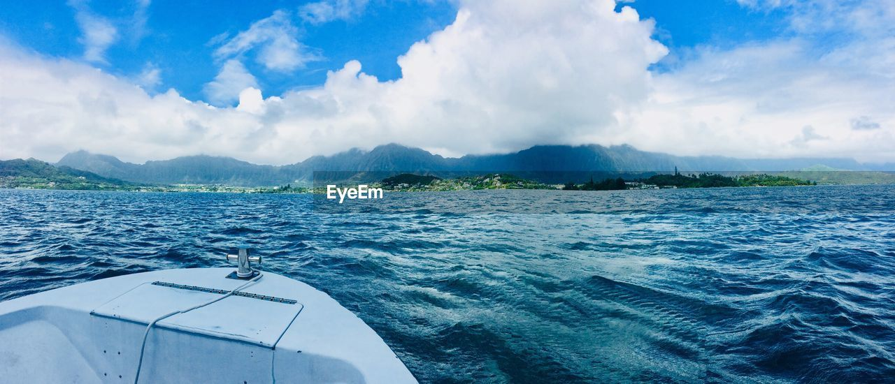 water, cloud - sky, sky, sea, transportation, nautical vessel, mode of transportation, beauty in nature, nature, scenics - nature, day, no people, travel, motion, sailing, outdoors, mountain, blue, on the move