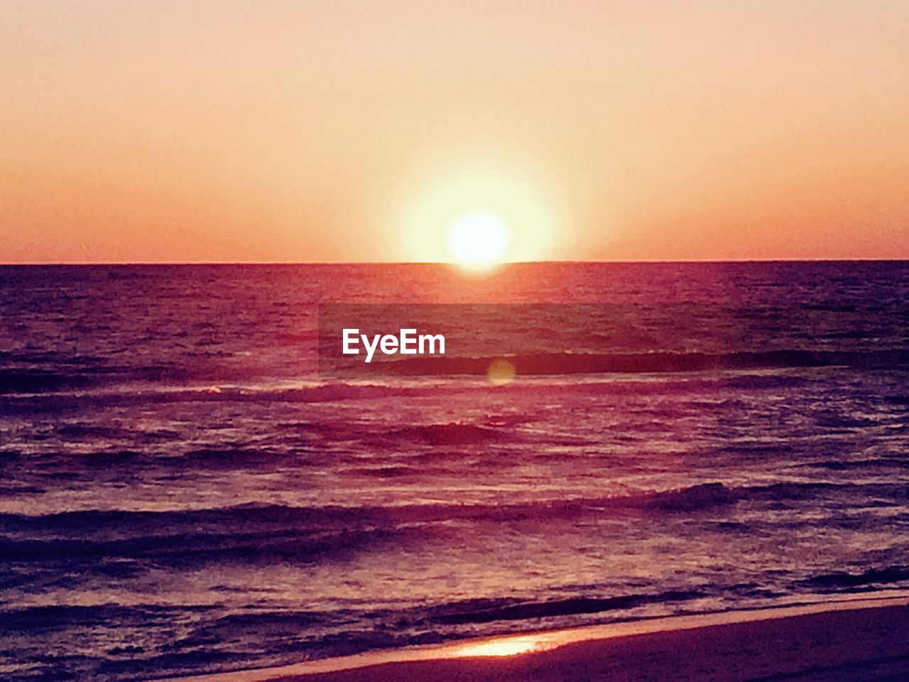sea, sunset, sun, beauty in nature, horizon over water, nature, scenics, water, tranquil scene, tranquility, idyllic, orange color, beach, sky, wave, no people, outdoors, sunlight, clear sky, day