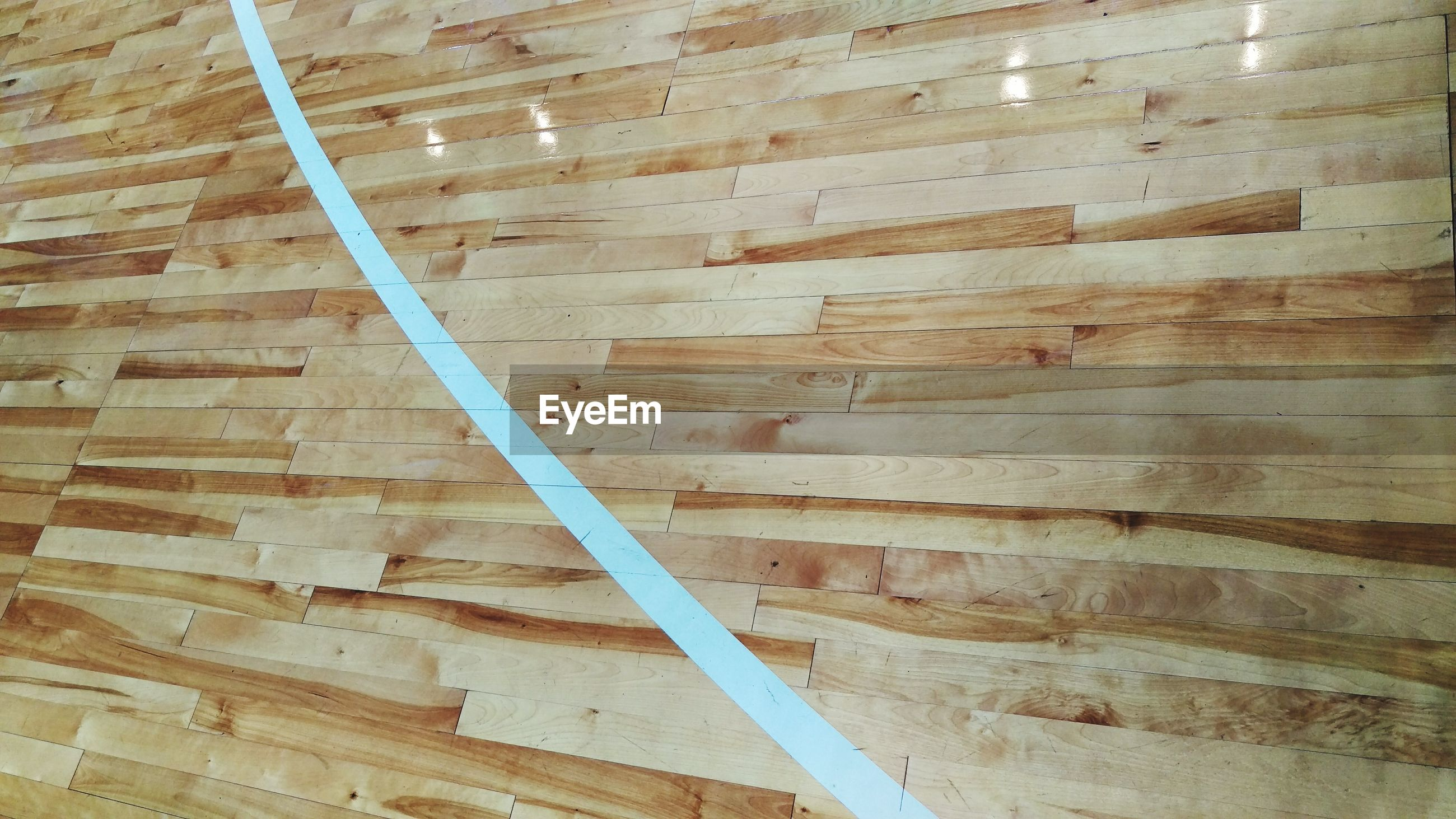 High angle view of wooden floor in basketball court