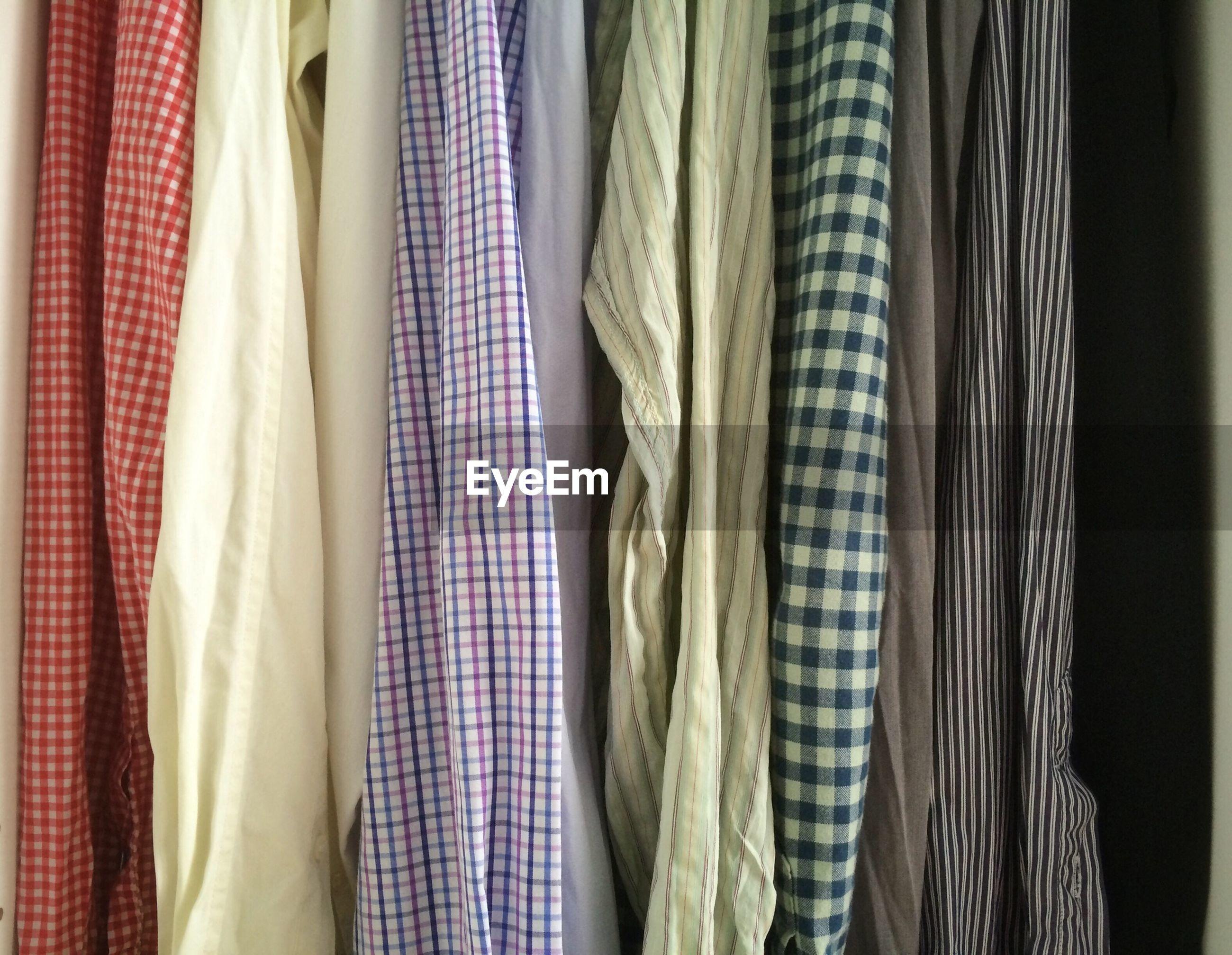 Close-up of shirts hanging in closet