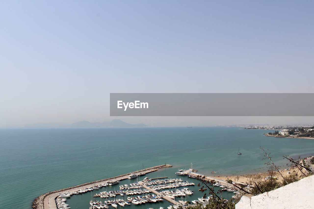 sky, water, sea, copy space, scenics - nature, nature, beauty in nature, clear sky, no people, nautical vessel, transportation, day, architecture, tranquility, beach, horizon over water, mode of transportation, tranquil scene, horizon, outdoors, luxury, yacht, turquoise colored