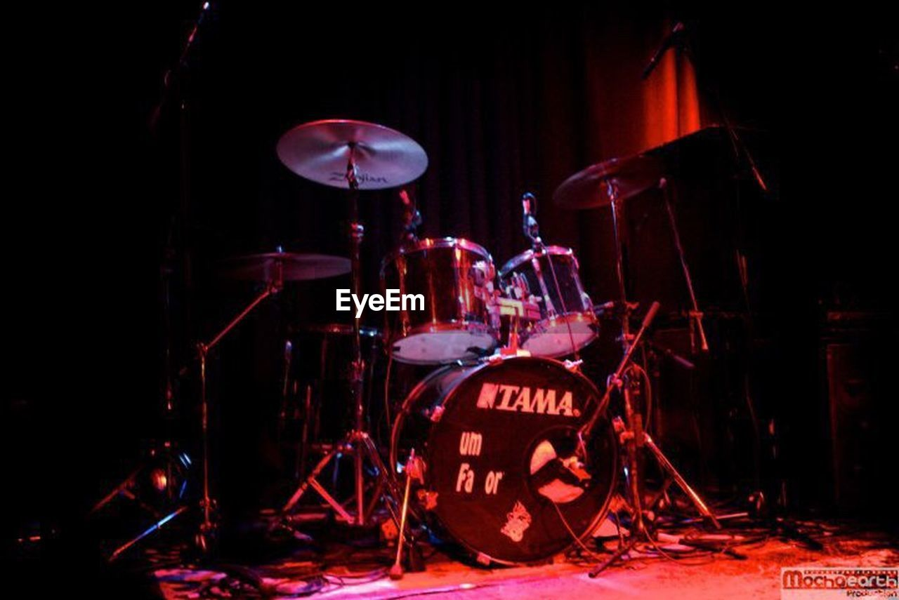 drum kit, drum - percussion instrument, stage - performance space, music, musical instrument, cymbal, arts culture and entertainment, red, microphone, indoors, rock music, performance, entertainment event, popular music concert, no people, electric guitar, performance group
