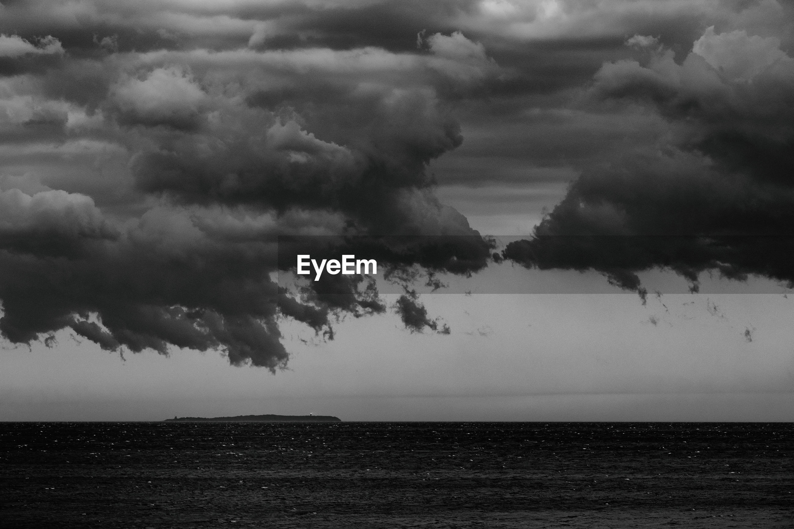 SCENIC VIEW OF SEA AGAINST STORM CLOUD SKY