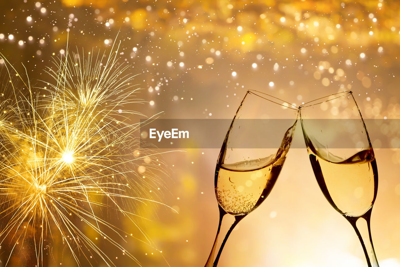celebration, illuminated, event, motion, glass, firework, focus on foreground, no people, glowing, close-up, night, firework display, nature, refreshment, drink, alcohol, glass - material, arts culture and entertainment, wine, light