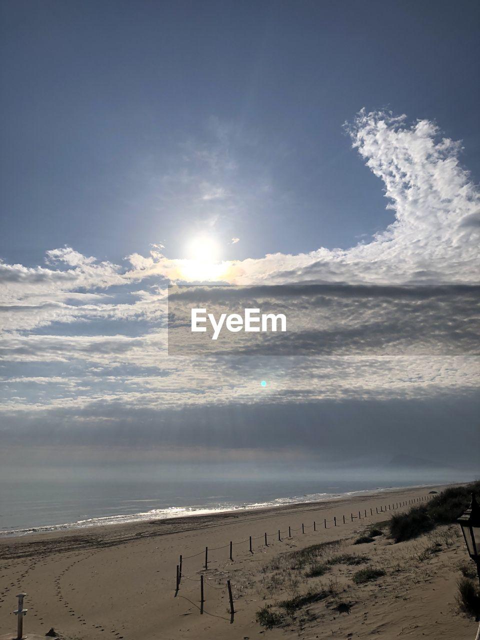 sky, cloud - sky, beauty in nature, scenics - nature, land, water, beach, sea, nature, sunlight, tranquil scene, sand, tranquility, sun, non-urban scene, day, idyllic, no people, horizon, outdoors, horizon over water, bright