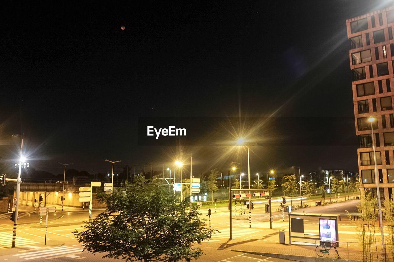 illuminated, night, street light, building exterior, lighting equipment, architecture, built structure, city, no people, outdoors, sky, light beam
